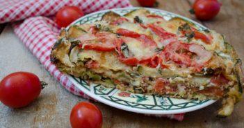 Parmigiana di zucchine con pomodorini e scamorza